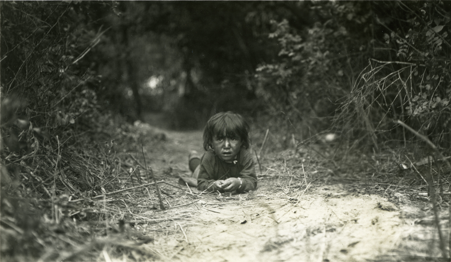 An Indian Boy in the Trail, Crow Reservation, Montana, 1909.  Photograph by Joseph Dixon.  Courtesy of the Mathers Museum, Wanamaker Collection,  Bloomington, I.N., W-2394.