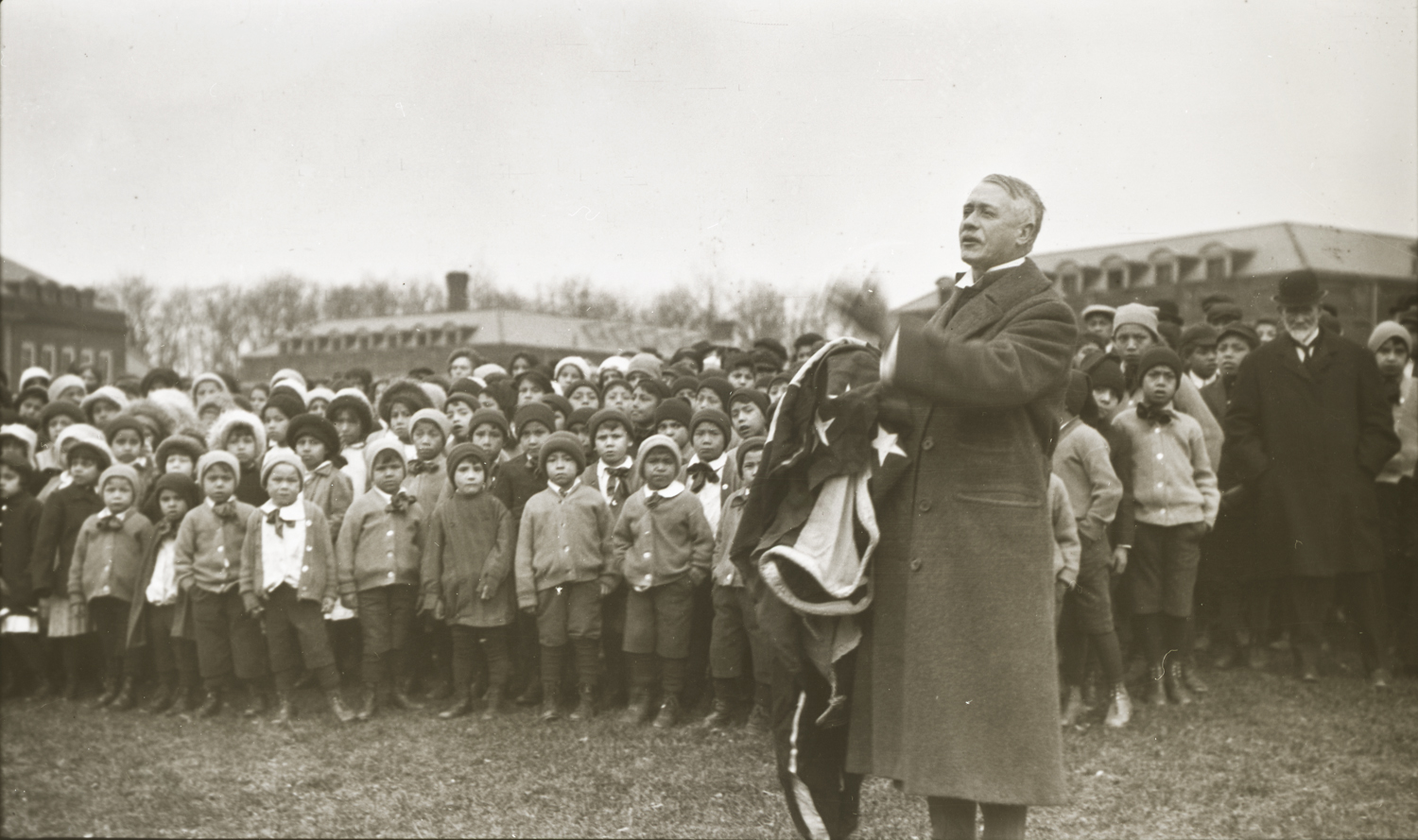 Thomas Indian School Children Listening to Dr. Dixon, November 28, 1913. Photograph by Joseph Dixon. Courtesy of the Mathers Museum of World Cultures, Wanamaker Collection, Indiana University, Bloomington, I.N., W-4311.